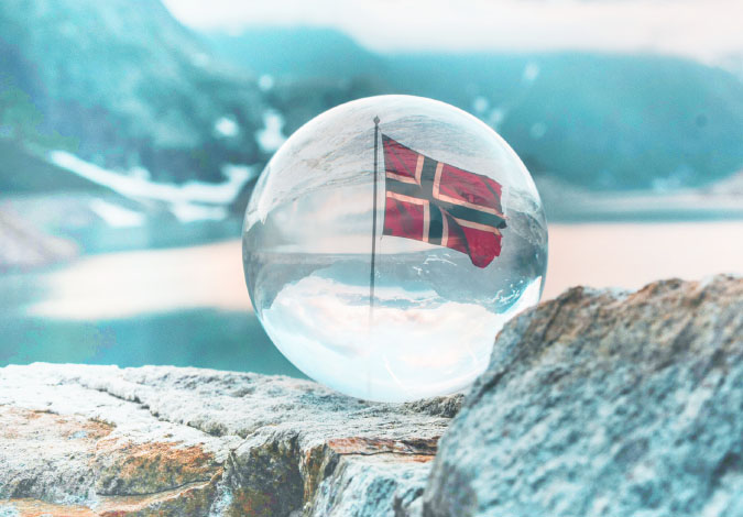 norway flag reflected in a glass sphere